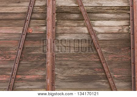 The siding of an old wooden railroad box car.
