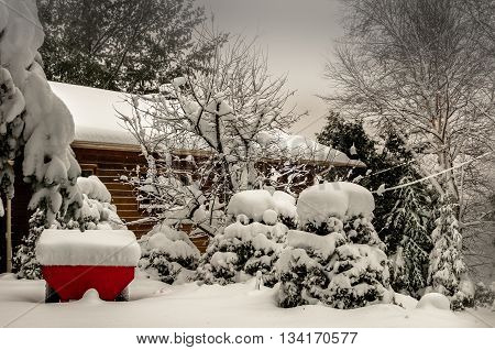 bad weather after snow storm with red trailer in front of a house Quebec Canada