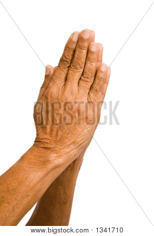Viejo manos rezando