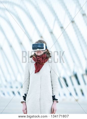 Woman Wearing A Virtual Reality Headset Standing In Futuristic Building