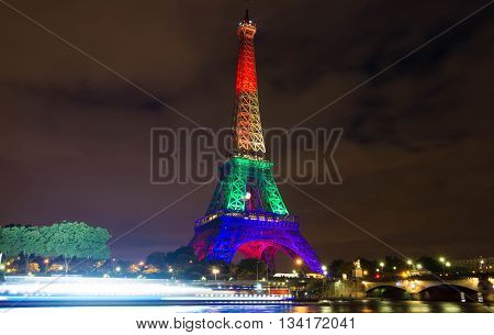Paris; France-June 13 2016 : The Eiffel tower lit up in colors of the rainbow flag in solidarity with the LGBT community after the Orlando terror attack.