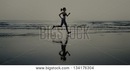 Woman Running Beach Morning Exercise Concept