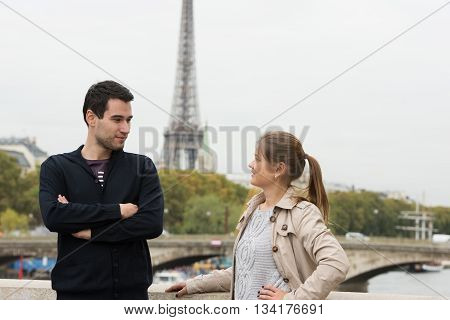 Young Couple In Paris Talking