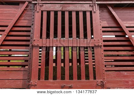 A door on an old wooden livestock railroad box car.