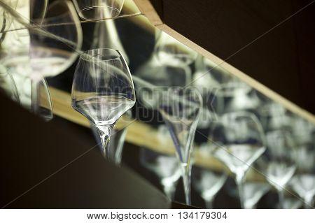Glasses on shelves in a wine bar