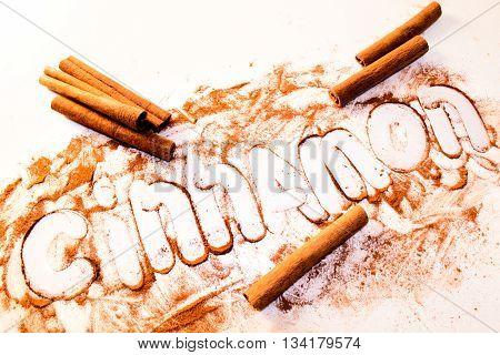 cinnamon spice on a white table. cinnamon sticks.