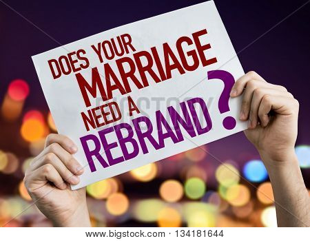 Does Your Marriage Need a Rebrand? placard with night lights on background