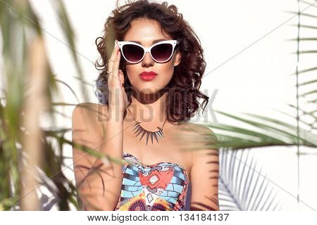 Summer style portrait of young attractive woman wearing sunglasses. Tropical summer holiday fashion beauty  concept