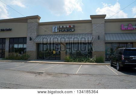 SHOREWOOD, ILLINOIS / UNITED STATES - AUGUST 16, 2015: One may have one's hair cut at the Salon Haiku, in a Shorewood strip mall.