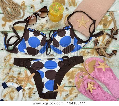 Swimsuit and starfish on a white background
