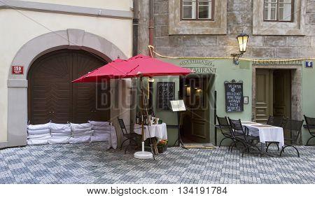 PRAGUE, CZECH REPUBLIC- JUNE 6, 2013: Street cafe during the floods