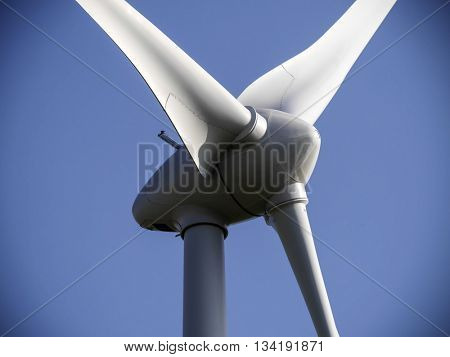 Closeup image of wind generator propeller with vignette edges.