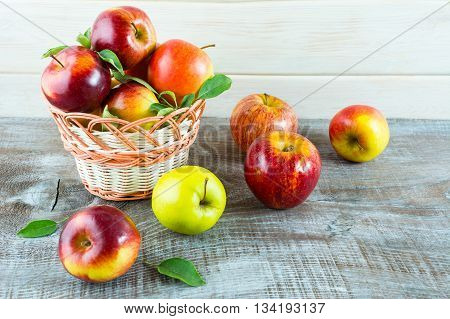 Ripe fresh apples in the wicker basket. Fresh fruits. Fresh apples. Healthy food. Healthy eating. Vegetarian food. Healthy eating concept.
