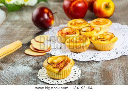 Sweet apple rose cake. Sweet gourmet cupcakes. Homemade sweet apple dessert. Homemade apple rose pastry.