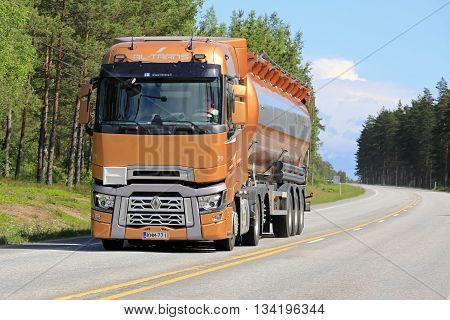 RAASEPORI, FINLAND - JUNE 5 2016: New orange Renault Trucks T semi tanker on the road in South of Finland at summer.