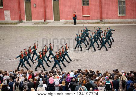 ST. PETERSBURG, RUSSIA - MAY 28, 2016: People watching honor guard ceremony in St. Peter and Paul fortress. The ceremony was held since the foundation of fortress till 1926, and then recreated in 2008