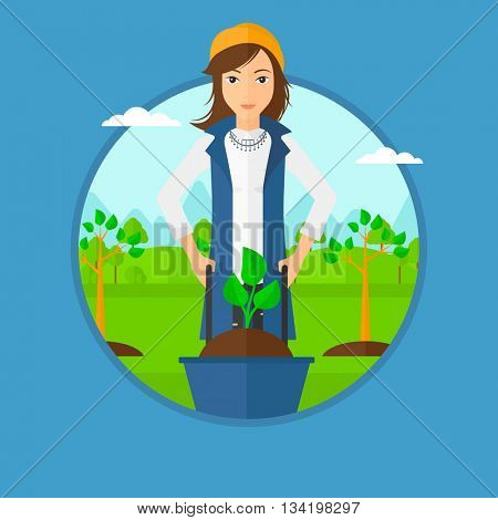 Woman pushing wheelbarrow with plant and dirt in the park. A gardener with wheelbarrow on a background of newly planted trees. Vector flat design illustration in the circle isolated on background.