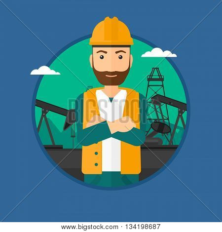 A hipster oil worker in uniform and helmet. An oil worker with crossed arms. An oil worker standing on a background of pump jack. Vector flat design illustration in the circle isolated on background.