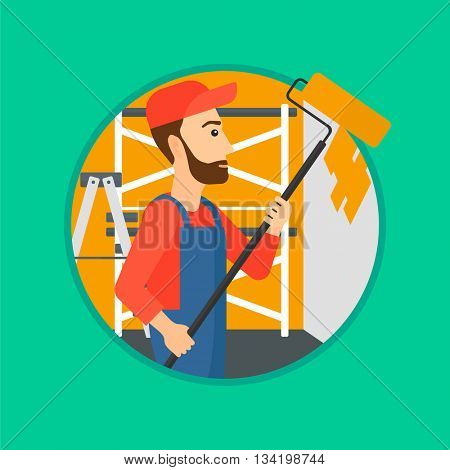 A hipster painter in overalls with a paint roller in hands. Painter painting walls with a paint roller in an apartment. Vector flat design illustration in the circle isolated on background.