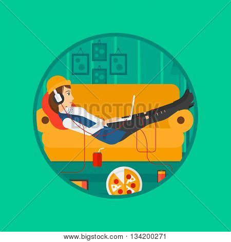 Woman relaxing on a sofa with many gadgets. Woman lying on sofa surrounded by gadgets and fast food. Woman using gadgets at home. Vector flat design illustration in the circle isolated on background.