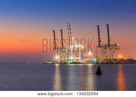 Cargo ship terminal at twilight scene Unloading crane of cargo ship terminal.