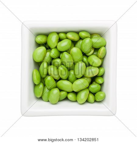 Green soy beans in a square bowl isolated on white background