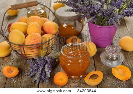Apricot jam with lavender on a wooden background