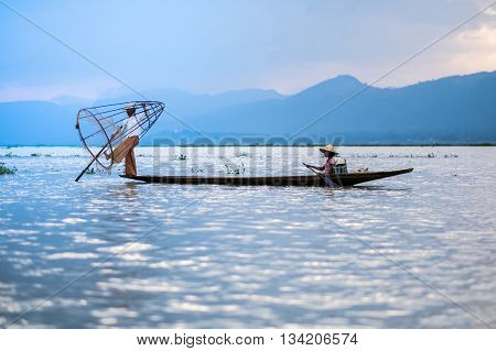 Mandalay - October 15: Fishermen Catch Fish Oct 15, 2014 In Mandalay. Fishermen Show Ancient Way Of