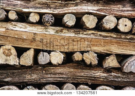 Background of stacked wooden logs. Year rings. Pile wood. Deforestation theme. Wood industry. Chopped wood. Woodpile scene.