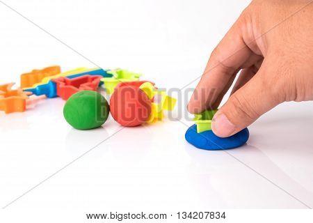 Hand Cutting Play Dough Via Plastic Block
