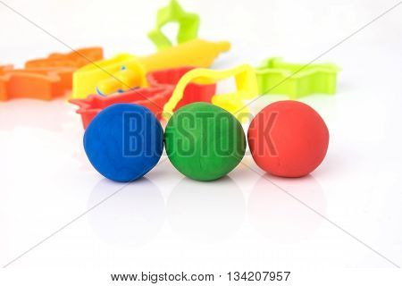 Ball Shape Of Play Dough On White Background. Colorful Play Dough.
