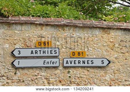 Wy dit Joli village France - august 8 2015 : road sign on anold wall