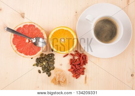 Healthy Breakfast With Fruits, Coffee, Goji Berries, Seeds And Ginger