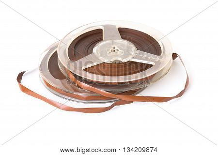 Vintage reel of audio tape isolated on white background