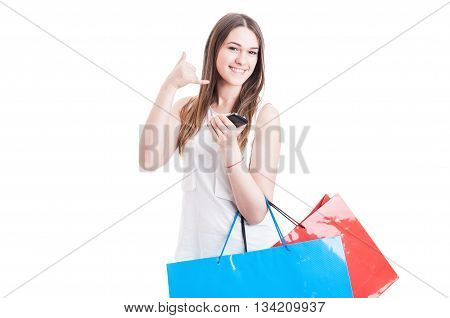 Happy Beautiful Shopper Holding Cellphone And Doing A Call Gesture