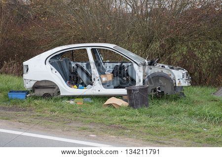 Front part of a crashed car wreck on the side of the road
