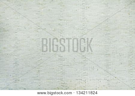 Brick wall painted with white paintWhite brick wall background.