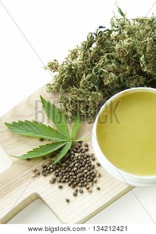 Cannabis home made healing ointment and marijuana green leaf and seeds
