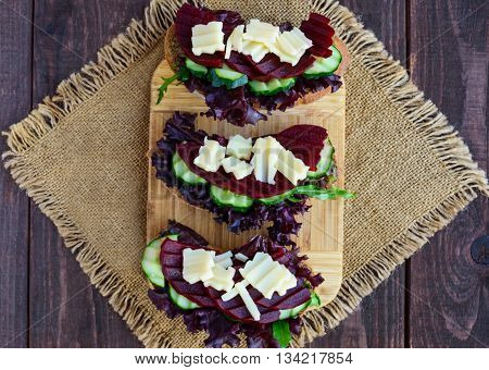 Dietary vitamin sandwiches with lettuce leaves cucumber beet and cheese on rye bread. The top view