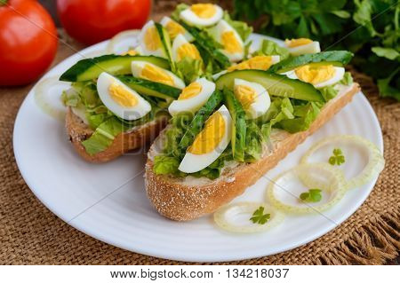 Fresh green sandwich with fresh cucumber Chinese cabbage quail egg. Dietary and vegetarian dishes.