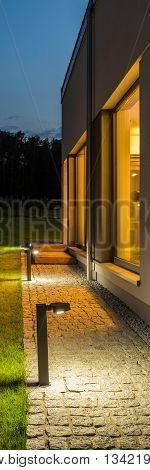 Villa Backyard Illuminated At Night