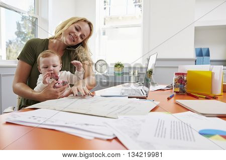 Busy Mother With Baby Running Business From Home
