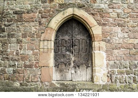Medieval Wooden Door in Stone Wall.  Wissembourg, Alsace, France