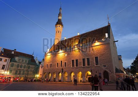 TALLINN ESTONIA- SEPTEMBER 5 2015 A crowd of tourists visit night Town hall square in the Old city on September 5 2015 in Tallinn Estonia.