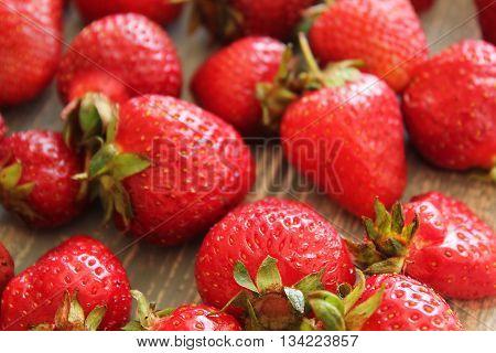 Strawberries on wooden grey desk. Stock photo.