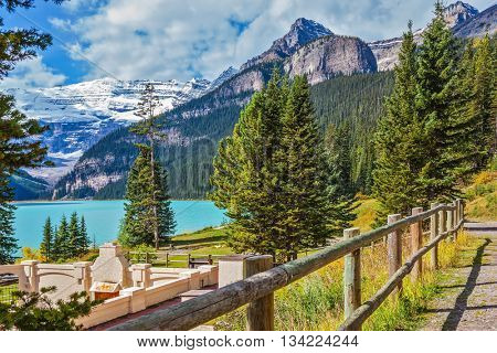 Low wooden fence on the shore of Lake Louise. Canada, Rocky Mountains, Alberta, Banff National Park