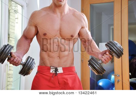 Powerful and sexy muscular man lifting weight