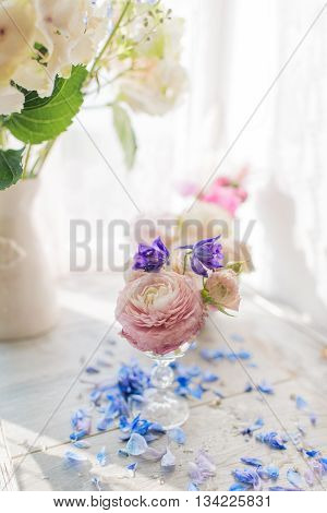 Vase with a delicate bouquet of pink roses