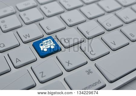 Free delivery truck icon on modern computer keyboard button Transportation business concept
