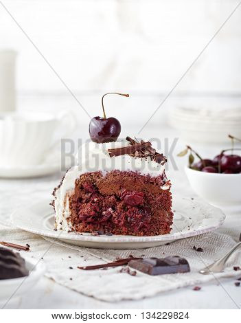Black forest cake decorated with whipped cream and cherries Schwarzwald pie dark chocolate and cherry dessert on a white plate